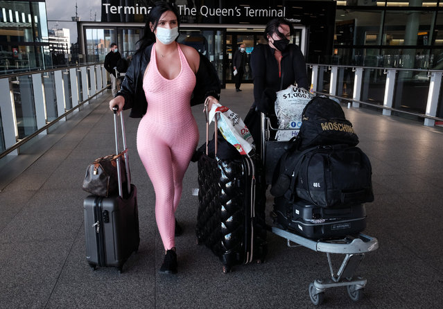 Elizabeth Svensson (right), 35 and Klaudia Zakrzewska, 27, from London, arrive back in the UK at Heathrow Terminal 2, after being on holiday in Dubai for 15 days, during England's third national lockdown to curb the spread of coronavirus on Friday January 29, 2021. (Photo by Yui Mok/PA Images via Getty Images)