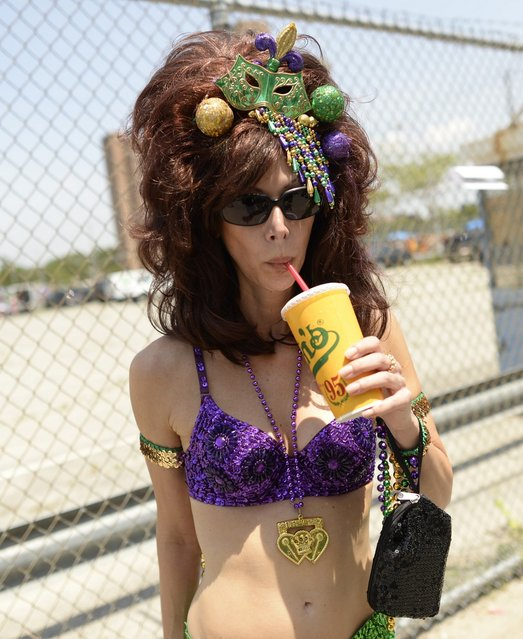 A parade participant arrives in costume for the 31st Annual Mermaid Parade at New York's Coney Island on June 22, 2103. Over 700,00 people are exptected to turn out for the  scantily clad parade. (Photo by Timothy Clary/AFP Photo)