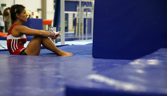 Brazilian gymnast Jade Barbosa takes a break during a training session at the new Brazilian Artistic Gymnastics Center in Rio de Janeiro January 16, 2015. (Photo by Sergio Moraes/Reuters)