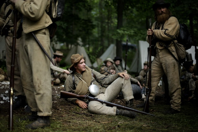 Members of the 1st Tennessee wait to take part in in a demonstration of a battle during ongoing activities commemorating the 150th anniversary of the Battle of Gettysburg, Friday, June 28, 2013, at  at Bushey Farm in Gettysburg, Pa.  Union forces turned away a Confederate advance in the pivotal battle of the Civil War fought July 1-3, 1863, which was also the war's bloodiest conflict with more than 51,000 casualties. (Photo by Matt Rourke/AP Photo)