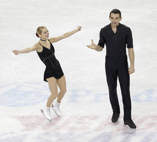 Alexa Scimeca, left, and Christopher Knierim react after their performance during the pairs short program at the U.S. Figure Skating Championships in Greensboro, N.C., Thursday, January 22, 2015. (Photo by Chuck Burton/AP Photo)