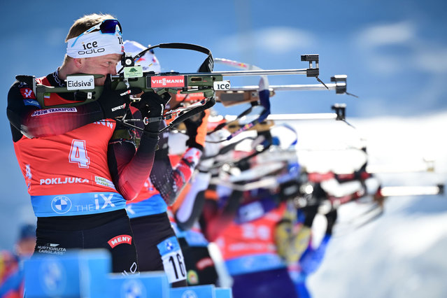Norway's Johannes Dale (L) competes at the shooting range  the Men's 12,5 km Pursuit event at the IBU Biathlon World Championships in Pokljuka, Slovenia, on February 14, 2021. (Photo by Jure Makovec/AFP Photo)