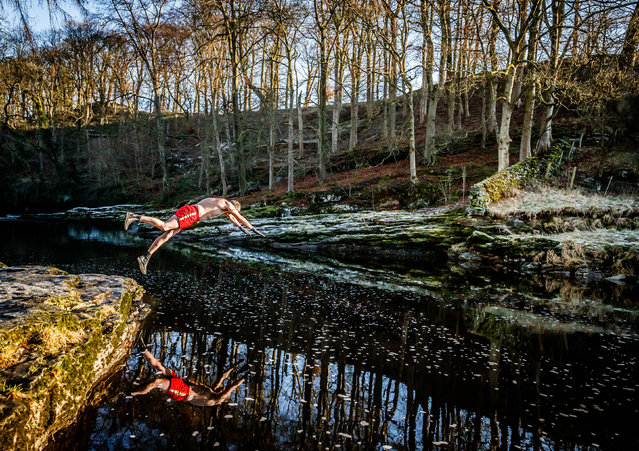 Les Peebles dives into the River Ribble near Stainforth in North Yorkshire, United Kingdom on January 6, 2021. Mr Peebles is swimming in the wild every day in January to raise money for the homelessness charity Crisis. (Photo by Danny Lawson/PA Images via Getty Images)
