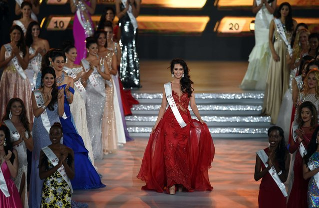 Catharina Choi Nunes, Miss World Brazil reacts after entering the semi final at the Miss World Grand Final in Sanya, in southern China's Hainan province on December 19, 2015. (Photo by Johannes Eisele/AFP Photo)