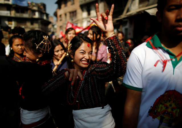 Participants from Newar community in traditional attire, dance during the Newari New Year parade that falls during the Tihar festival, also called Diwali, in Kathmandu, Nepal October 31, 2016. (Photo by Navesh Chitrakar/Reuters)