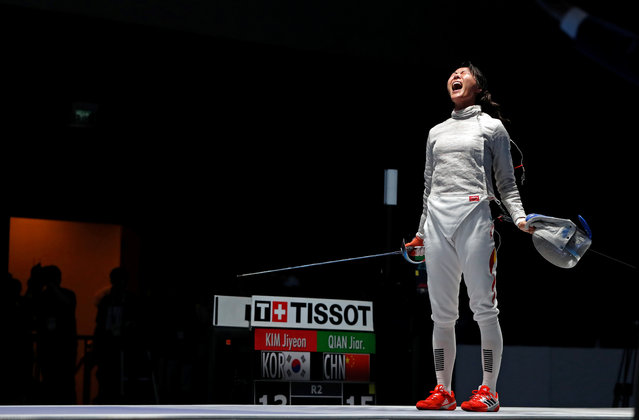 China' s Qian Jiarui reacts after winning against South Korea' s Kim Jiyeon in their women' s sabre individual semifinal during the 2018 Asian Games in Jakarta on August 19, 2018. (Photo by Reuters/Beawiharta)