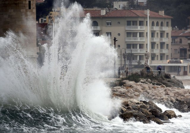 A wave crashes in the port of Cassis, near Marseille, France as stormy weather with high winds hits part of the French Mediterranean coast January 11, 2016. (Photo by Jean-Paul Pelissier/Reuters)