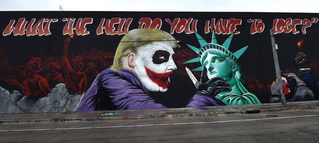 A Donald Trump mural covers a building in the Wynwood neighborhood of Miami, Florida, on October 27, 2016. The Anti-Trump, batman themed mural was created by the artists of the Bushwick Collective ahead of the US presidential election. (Photo by Rhona Wise/AFP Photo)