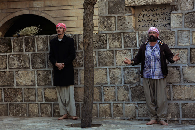 Yazidi men pray at a Yazidi temple in Lalish, Shikhan province, Kurdistan, northern Iraq, December 7, 2016. (Photo by Ari Jalal/Reuters)