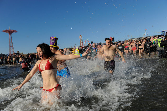 People participate in the annual Polar Bear Plunge in Coney Island in the Brooklyn Borough of New York City, U.S. January 1, 2017. (Photo by Stephanie Keith/Reuters)