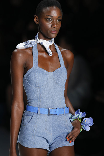 A model wears a creation from the TNG Summer collection during a Sao Paulo Fashion Week show in Sao Paulo, Brazil, Monday, April 13, 2015. (Photo by Andre Penner/AP Photo)