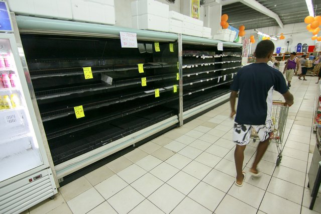 The refrigerated section of a supermarket lays empty of products after power losses due to Cyclone Winston in Fiji's capital Suva, February 22, 2016. (Photo by Steven Saphore/Reuters)