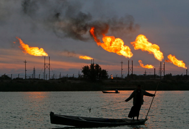 Flames emerge from flare stacks at the oil fields in Basra, southeast of Baghdad, Iraq January 17, 2017. (Photo by Essam Al-Sudani/Reuters)