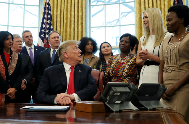 "White House senior advisor Ivanka Trump speaks as U.S. President Donald Trump participates in a presidential memorandum signing for the ""Women's Global Development and Prosperity"" initiative in the Oval Office at the White House in Washington, U.S., February 7, 2019. (Photo by Leah Millis/Reuters)"