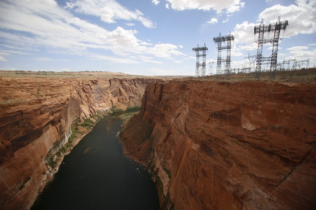 The Colorado River flows from the Glen Canyon Dam on Lake Powell outside Page, Arizona, April, 14, 2015. (Photo by Jim Urquhart/Reuters)