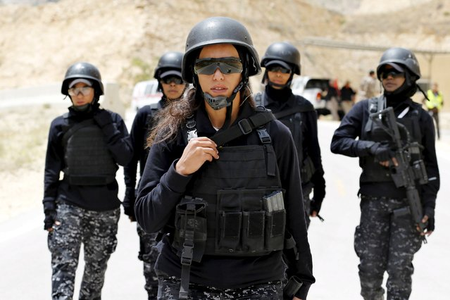 Members of the Jordanian police women's team attend the 7th Annual Warrior Competition at the King Abdullah Special Operations Training Center in Amman April 22, 2015. Thirty-eight teams from 18 countries are participating in the competition to test their military skills. (Photo by Muhammad Hamed/Reuters)