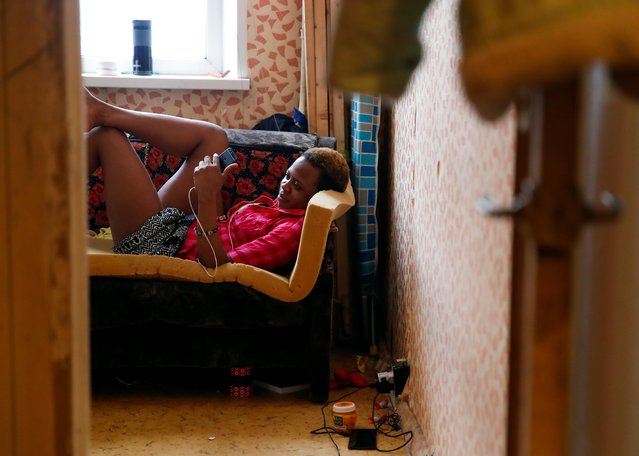 "Blessing Obuson, 19, rescued from human traffickers, chats on her smartphone in a shelter on the outskirts of Moscow, Russia February 21, 2019. Obuson thought Russia's World Cup would be an opportunity to find a job and flew into Moscow from Nigeria last June on a fan ID. Instead, she found herself forced to work as a prostitute. She said she was locked in a flat on the outskirts of Moscow and forced into s*x work along with 11 other Nigerian women who were supervised by a madam, also from Nigeria. ""I cried really hard. But what choice did I have?"" Obuson told Reuters after being freed by anti-slavery activists. She said her madam had confiscated her passport and told her she'd only get it back once she'd worked off a fictional debt of $50,000. (Photo by Maxim Shemetov/Reuters)"