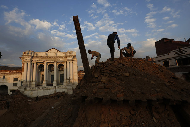 Nepalese students and volunteers clear the rubble at  Kathmandu Durbar Square, a UNESCO World Heritage Site, in Kathmandu, Nepal, Wednesday, April 29, 2015. (Photo by Manish Swarup/AP Photo)