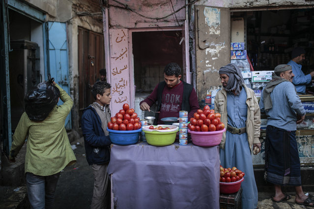A Yemeni street vendor sells tomato chutney at Souq al-Melh marketplace in the old city of Sanaa, Yemen, Tuesday December 11, 2018. (Pgoto by Hani Mohammed/AP Photo)