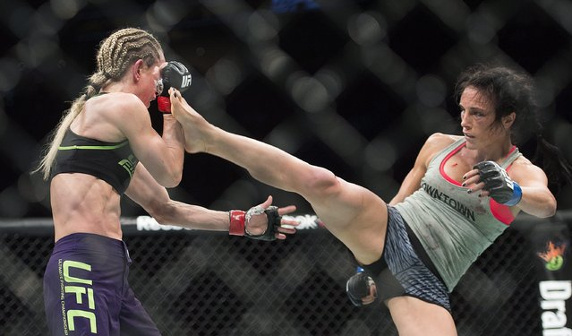Valerie Letourneau, right, from Canada, lands a kick to the head of Jessica Rakoczy, from Canada, during their UFC 186 mixed marital arts bout in Montreal, Saturday, April 25, 2015. (Photo by Graham Hughes/The Canadian Press via AP Photo)