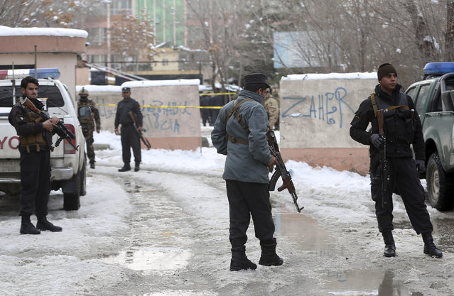Security personnel stand guard at the site of a suicide attack on the Supreme Court in Kabul, Afghanistan, Tuesday, February 7, 2017. An official says a suicide bomber has struck near the Supreme Court building in Kabil, killing several people. (Photo by Massoud Hossaini/AP Photos)