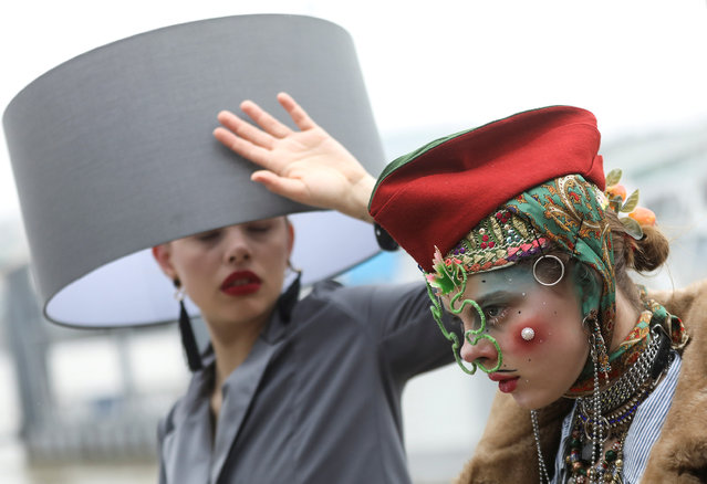 "Participants pose for photographs as they take part in a ""Hat Walk"" during London Hat Week in London, Britain April 7, 2019. (Photo by Simon Dawson/Reuters)"