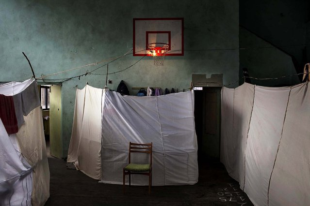 1st prize in the General News Single category. Alessandro Penso, Italy, for OnOff Picture. The photo shows Military Ramp, an emergency refugee center in an abandoned school in Sofia, Bulgaria, November 21, 2013. The center provides housing for about 800 Syrian refugees, including 390 children. (Photo by Alessandro Penso/World Press Photo)
