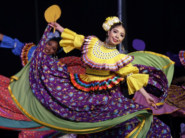 A dancer performs during Cinco de Mayo celebrations in Portland, Ore., Tuesday, May 5, 2015. (Photo by Don Ryan/AP Photo)