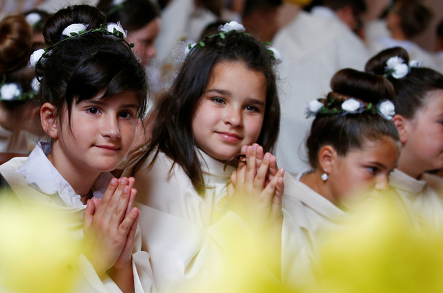 Faithful wait for Pope Francis to lead the Holy Mass with First Communions at Most Holy Heart of Jesus church in Rakovski, Bulgaria on May 6, 2019. (Photo by Yara Nardi/Reuters)