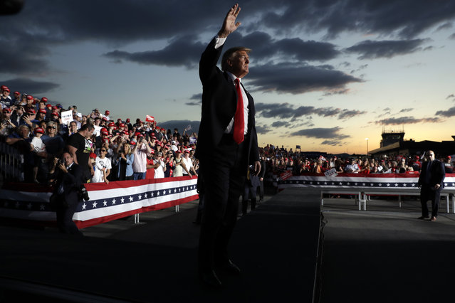 President Donald Trump waves to the crowd as he finishes speaking at a campaign rally, Monday, May 20, 2019, in Montoursville, Pa. (Photo by Evan Vucci/AP Photo)