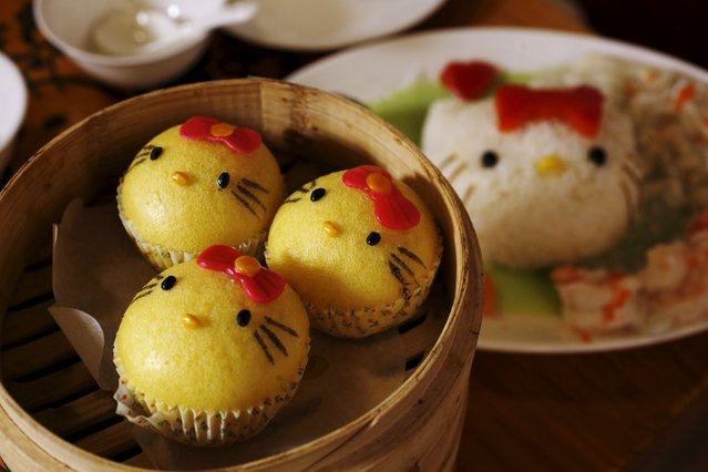 Decorated buns (L) and a dish (R) of steamed rice with spinach sauce and egg white are seen at a Hello Kitty-themed Chinese restaurant in Hong Kong, China May 21, 2015. (Photo by Bobby Yip/Reuters)