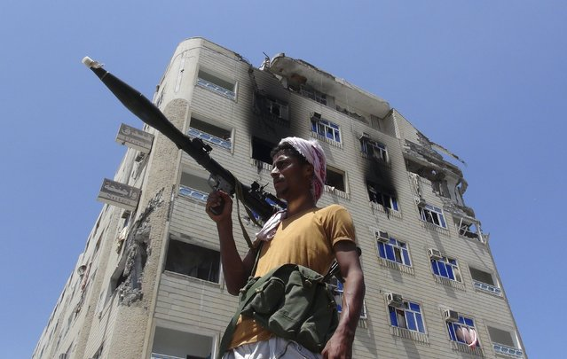A Southern Popular Resistance fighter secures a street during fighting against Houthi fighters in the Dar Saad district of Yemen's southern port city of Aden May 9, 2015. (Photo by Reuters/Stringer)