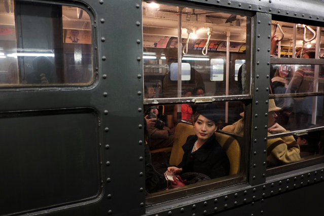 A woman dressed in period costume sits in a vintage New York City subway on December 16, 2012 in New York City. The New York Metropolitan Transportation Authority (MTA) runs vintage subway trains from the 1930's-1970's each Sunday along the M train route from Manhattan to Queens through the first of the year. (Photo by Preston Rescigno/Getty Images)