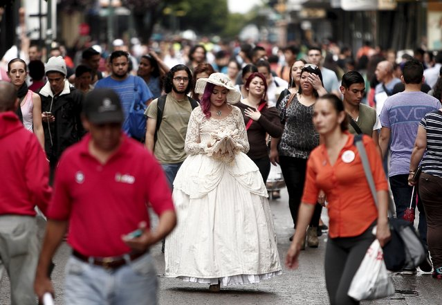 "Adriana Barahona, known as "" Madame Barocle,"" wearing clothing of the Victorian era, walks along a central avenue in San Jose, Costa Rica, June 4, 2015. Barahona says she has been passionate about clothing from the era of Britain's Queen Victoria (1837-1901), and has been making and wearing them since the age of 15. REUTERS/Juan Carlos Ulate"