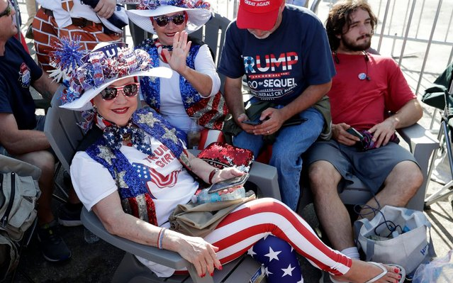 Supporters of President Donald Trump wait in line hours before the arena doors open for a campaign rally Tuesday, June 18, 2019, in Orlando, Fla. (Photo by John Raoux/AP Photo)