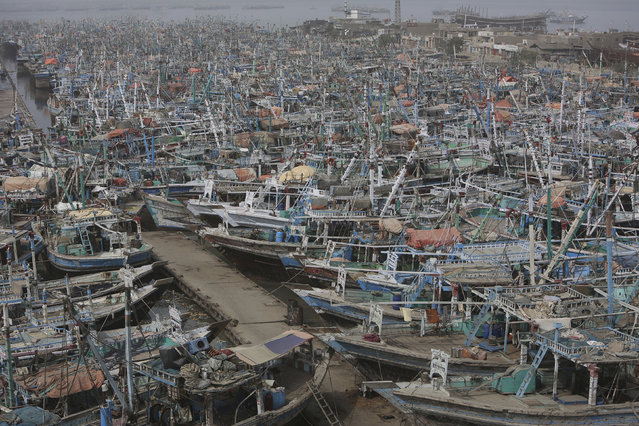 Pakistani fishing boats are called back from the sea following a warning by authorities of Cyclone Vayu at Karachi harbor in Pakistan, Thursday, June 13, 2019. The meteorological department Thursday issued an alert, warning fishermen to avoid fishing in the Arabian sea this week as the Cyclone Vayu could cause rough conditions in the sea. (Photo by Fareed Khan/AP Photo)
