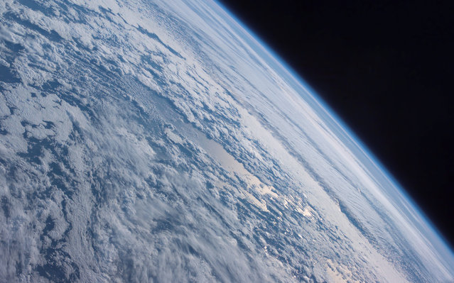 Earth's horizon against the blackness of space is featured in this image photographed by an Expedition 7 crewmember onboard the International Space Station (ISS), October 4, 2003. (Photo by NASA)