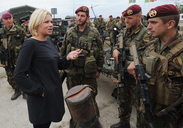 Defense Minister of the Netherlands Jeanine Hennis-Plasschaert speaks with Dutch soldiers after the NATO Noble Jump exercise on a training range near Swietoszow Zagan, Poland, Thursday, June 18, 2015. (AP Photo/Alik Keplicz)