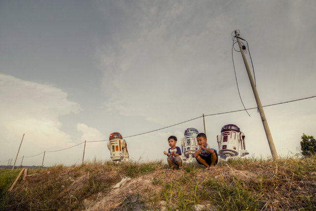 Three R2 units take in the Malaysian landscape. (Photo by Zahir Batin/Mercury Press)