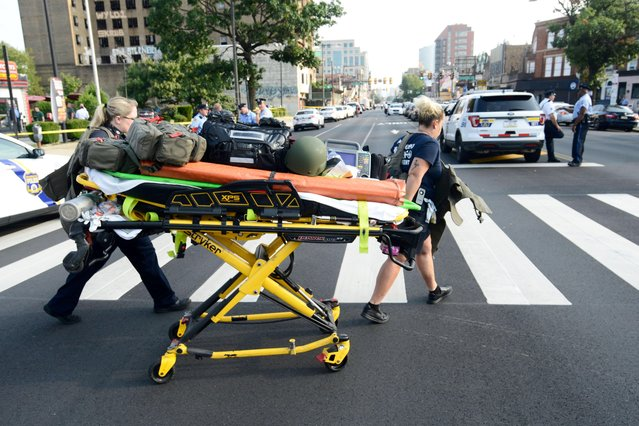 Paramedics roll a stretcher near the scene of a shooting incident in which several police were injured in Philadelphia, Pennsylvania, U.S. August 14, 2019. (Photo by Bastiaan Slabbers/Reuters)