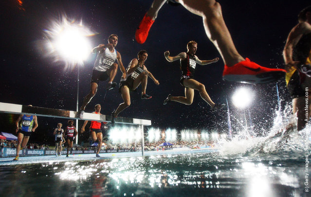 Competitors jump into the water during the Malinowski Mens 3000m Steeple during the 2011 Zatopek Classic at the Victorian Athletics Centre