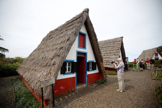 Tourists visit Madeira's traditional houses in Santana on Madeira's North coast, Portugal March 30, 2017. (Photo by Rafael Marchante/Reuters)