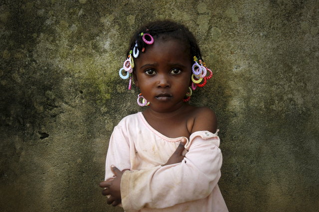 Abiba, 3, poses for a picture a day ahead of the International Day of the African Child, in Abidjan, Ivory Coast June 15, 2015. (Photo by Luc Gnago/Reuters)