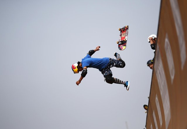 A skateboarder falls as he competes at the Vert Ramp competition during the World Extreme Games in Shanghai April 30, 2014. (Photo by Carlos Barria/Reuters)