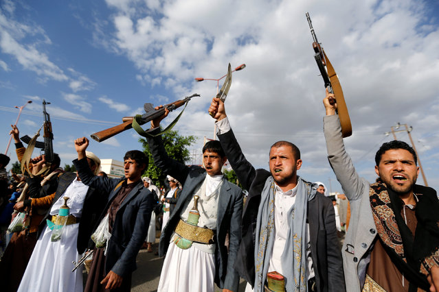 Houthi followers hold up their rifles as they shout slogans during a demonstration against the U.S. intervention in Yemen, in the country's capital Sanaa, May 13, 2016. (Photo by Khaled Abdullah/Reuters)