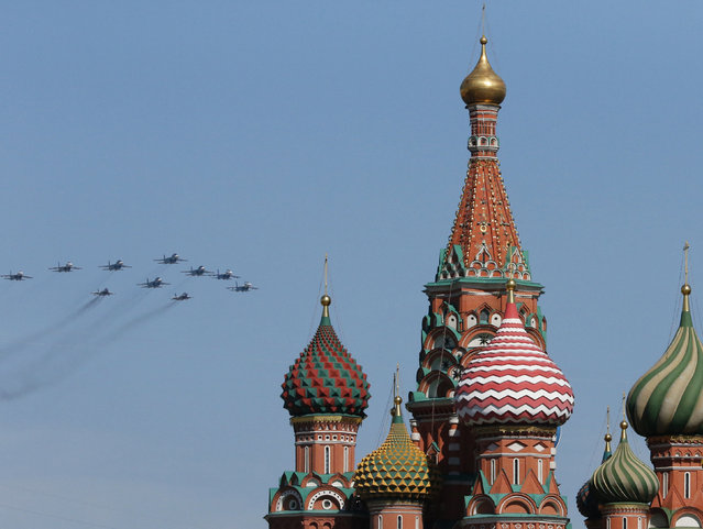 Russian military planes fly above Saint Basil's Cathedral during the Victory Day parade in Moscow's Red Square May 9, 2014. (Photo by Artur Bainozarov/Reuters)