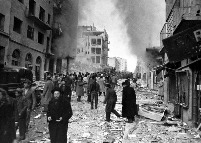 Two trucks exploded on Ben Yehuda Street, in the heart of the Jewish business district of Jerusalem, February 2, 1948, killing 27 people and injuring more than 100 others. (Photo by AP Photo/Pringle)