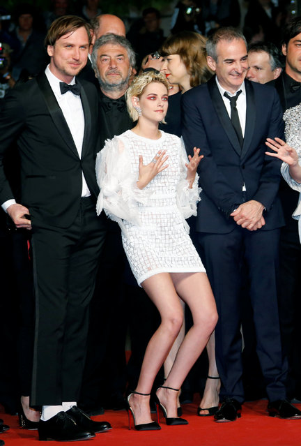 "Director Olivier Assayas (R) and cast members Lars Eidinger and Kristen Stewart (L) pose on red carpet as they arrive for the screening of the film ""Personal Shopper"" in competition at the 69th Cannes Film Festival in Cannes, France, May 17, 2016. (Photo by Jean-Paul Pelissier/Reuters)"