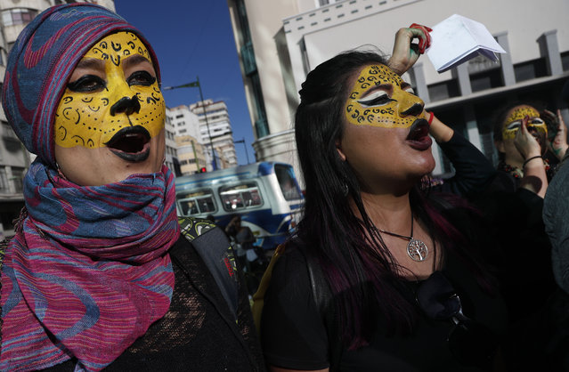 "Activists with their faces painted like jaguars shout slogans that elections were a farce, as they protest the reelection of President Evo Morales, in La Paz, Bolivia, Wednesday, October 30, 2019. Bolivia's government said Wednesday the Organization of American States is sending a 30-person team to launch a ""binding"" audit of a presidential election that the opposition says was manipulated to ensure the re-election of Morales. (Photo by Juan Karita/AP Photo)"