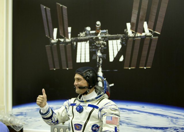 The International Space Station (ISS) crew member Kjell Lindgren of the U.S. gestures after donning his space suit at the Baikonur cosmodrome, Kazakhstan, July 22, 2015. (Photo by Shamil Zhumatov/Reuters)